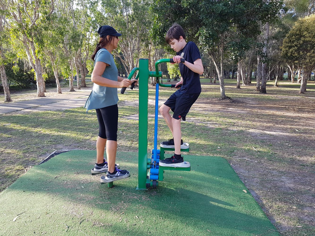 bec and boy at outdoor gym