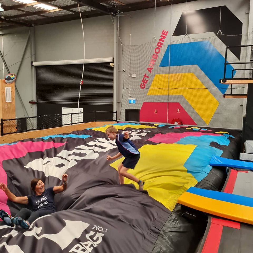 support services and boy playing on indoor trampoline