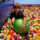 Boy amongst colourful balls