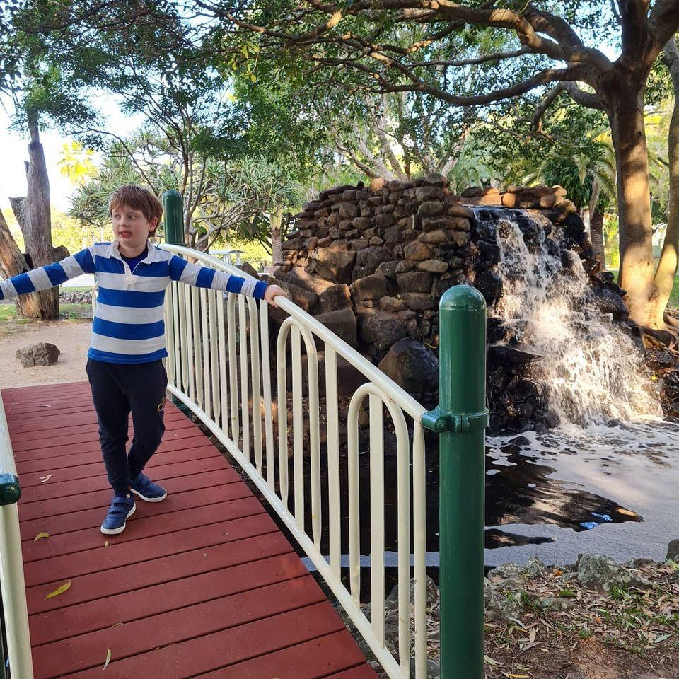 young boy on bridge